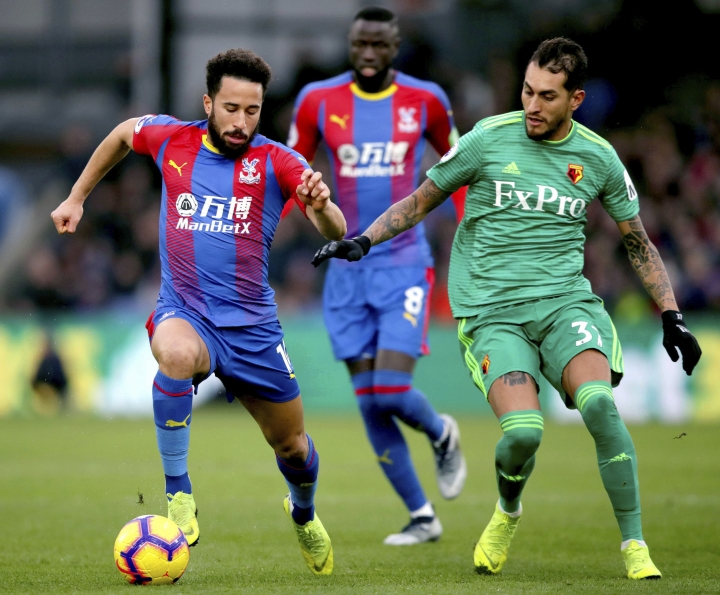 Crystal Palace's Andros Townsend, left, and Watford's Roberto Pereyra compete for the ball during the English Premier League soccer match between Crystal Palace and Watford Town at the Selhurst Park stadium, London. Saturday, Jan. 12, 2019 (John Walton/PA via AP)