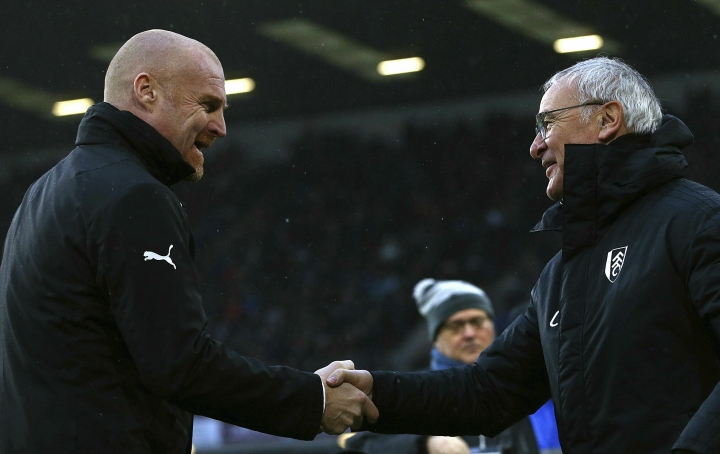 Burnley manager Sean Dyche, left, greets Fulham manager Claudio Ranieri during the English Premier League soccer match between Burnley F.C and Fulham at the Turf Moor stadium, Burnley, England. Saturday, Jan. 12, 2019. (Dave Thompson/PA via AP)