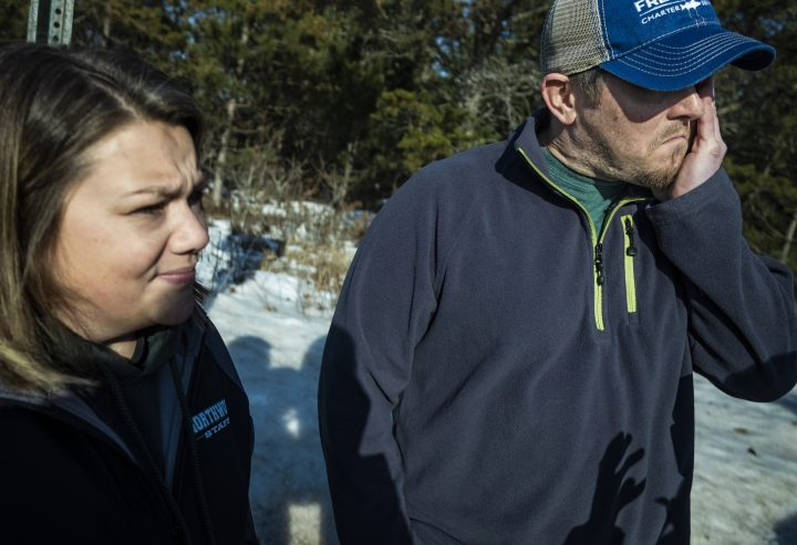 Kristin Kasinskas, who lives on S. Eau Claire Acres Circle with her husband, Peter, speak with the media Friday, Jan. 11, 2019, in Gordon, Wis. Kristin Kasinskas called 911 on Thursday, to report that Jayme Closs, 13, had been found after another neighbor out walking her dog encountered her and brought her to Kasinskas' house. Closs went missing in October after her parents were killed. (Richard Tsong-Taatarii/Star Tribune via AP)