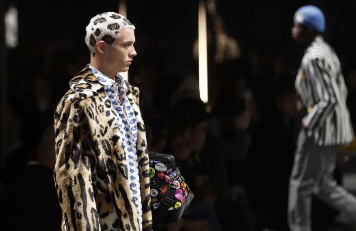 A model wears a creation as part of the Versace men's Fall-Winter 2019-20 collection, that was presented in Milan, Italy, Saturday, Jan.12, 2019. (AP Photo/Antonio Calanni)