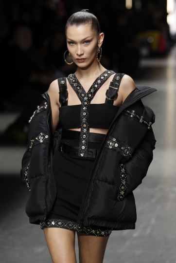 Supermodel Bella Hadid wears a creation as part of the Versace men's Fall-Winter 2019-20 collection, that was presented in Milan, Italy, Saturday, Jan.12, 2019. (AP Photo/Antonio Calanni)