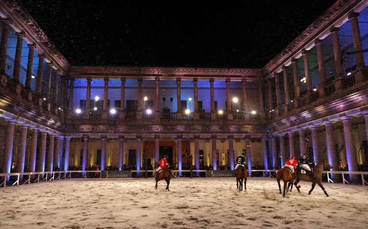 Players ride their horses as they perform in an exhibition polo match prior to the start of the presentation of the Billionaire men's Fall-Winter 2019-20 collection, unveiled during the Fashion Week in Milan, Italy, Saturday, Jan.12, 2019. (AP Photo/Antonio Calanni)