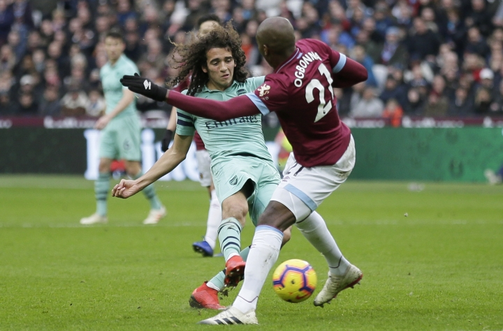 Arsenal's Matteo Guendouzi attempts a shot past West Ham's Angelo Ogbonna, right, during the English Premier League soccer match between West Ham United and Arsenal at London Stadium in London, Saturday, Jan. 12, 2019. (AP Photo/Tim Ireland)