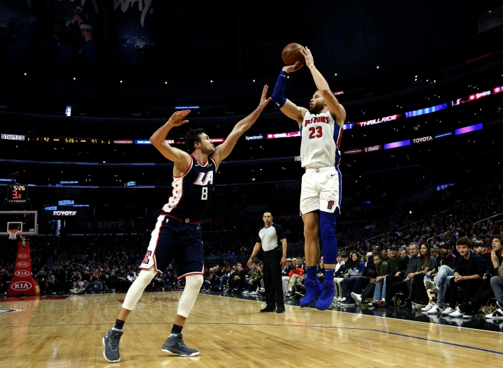 Detroit Pistons' Blake Griffin, right, shoots over Los Angeles Clippers' Danilo Gallinari during the second half of an NBA basketball game Saturday, Jan. 12, 2019, in Los Angeles. (AP Photo/Ringo H.W. Chiu)