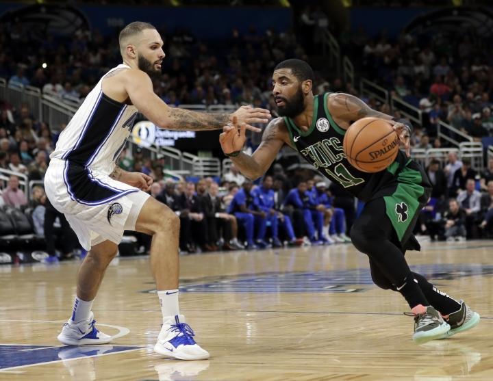 Boston Celtics' Kyrie Irving, right , drives around Orlando Magic's Evan Fournier during the second half of an NBA basketball game, Saturday, Jan. 12, 2019, in Orlando, Fla. (AP Photo/John Raoux)
