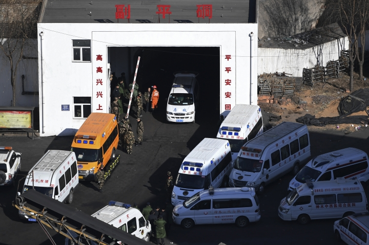 In this photo released by Xinhua News Agency, ambulance vehicles and rescuers gather at the Lijiagou coal mine of the Baiji Mining Co., Ltd. in Shenmu City, northwest China's Shaanxi Province, Sunday, Jan. 13, 2019. Twenty-one coal miners were killed when a mine collapsed in northern China, state media reported Sunday. (Li Yibo/Xinhua via AP)