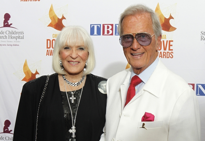 FILE - In this Oct. 7, 2014 file photo, Pat Boone, right, and wife Shirley Boone arrive at Lipscomb University for the Dove Award, in Nashville, Tenn. Shirley Boone, the longtime wife of singer Pat Boone as well as a philanthropist, has died at age 84. Milt Suchin, Pat Boone's manager, says in a statement that Shirley Boone passed away on Friday, Jan. 11, 2019, surrounded by her four daughters, who sang to her. (Photo by Wade Payne/Invision/AP, File)