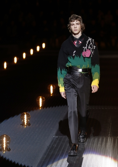 A model wears a creation as part of the Prada men's Fall-Winter 2019-20 collection, that was presented in Milan, Italy, Sunday, Jan.13, 2019. (AP Photo/Antonio Calanni)