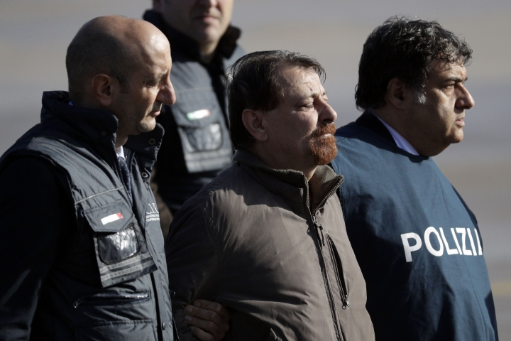 Italian fugitive Cesare Battisti arrives at Ciampino military airport, in Rome, Monday, Jan. 14, 2019. Battisti a left-wing Italian militant who was convicted of murder three decades ago is heading home to serve a life sentence, after his life as a celebrity fugitive came to an abrupt end with his arrest in Bolivia by a team of Interpol agents. (AP Photo/Gregorio Borgia)