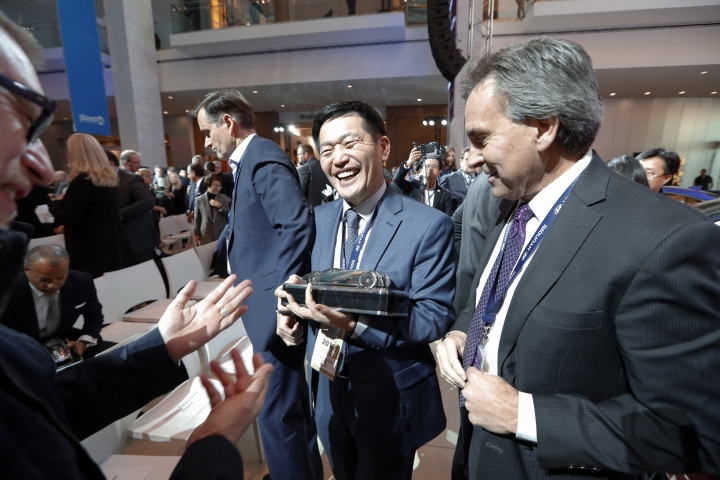 Yong-woo William Lee, left, President and CEO of Hyundai Motor North America and Brian Smith, Chief Operating Officer, Hyundai Motor America hold the North American SUV of the Year trophy for the Hyundai Kona during media previews for the North American International Auto Show in Detroit, Monday, Jan. 14, 2019. (AP Photo/Paul Sancya)