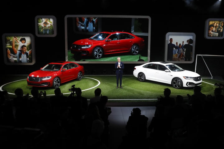 Scott Keogh, President and CEO, Volkswagen Group of America, Inc., introduces the 2020 Volkswagen Passat during media previews for the North American International Auto Show in Detroit, Monday, Jan. 14, 2019. (AP Photo/Paul Sancya)