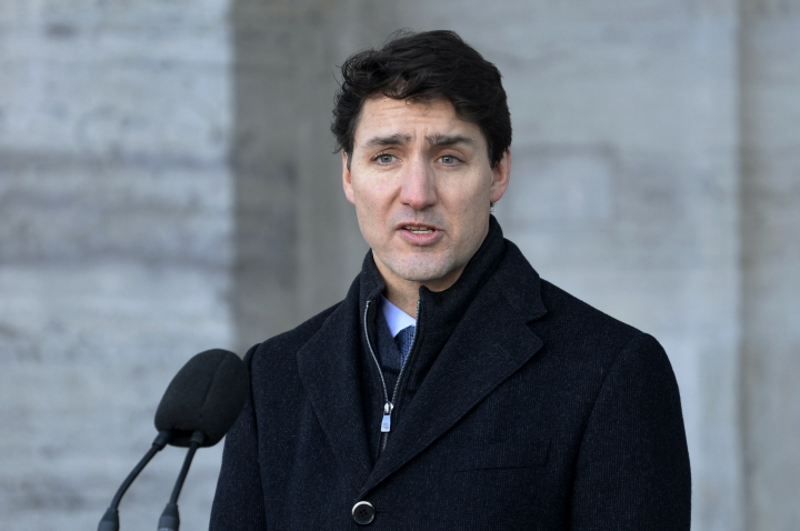 "Prime Minister Justin Trudeau addresses the media in Ottawa, Ontario on Monday, Jan. 14, 2019. A Chinese court sentenced Robert Lloyd Schellenberg, a Canadian man to death Monday in a sudden retrial in a drug smuggling case. Trudeau said he is extremely concerned that China chose to ""arbitrarily"" apply the death penalty to a Canadian citizen. (Adrian Wyld/The Canadian Press via AP)"