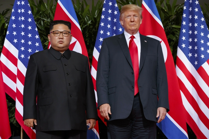 """FILE - In this June. 12, 2018, file photo, U.S. President Donald Trump, right, meets with North Korean leader Kim Jong Un on Sentosa Island, in Singapore. South Korea has stopped calling North Korea an """"enemy"""" in its biennial defense document published Tuesday, Jan. 15, 2019 in an apparent effort to continue reconciliation with Pyongyang. The development comes as U.S. and North Korean leaders are looking to set up their second summit to defuse an international standoff over the North's nuclear program. (AP Photo/Evan Vucci, File)"""