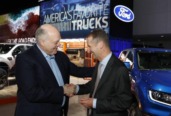 Ford Motor Co. President and CEO, Jim Hackett, left, meets with Dr. Herbert Diess, CEO of Volkswagen AG, Monday, Jan. 14, 2019, at the North American International Auto Show in Detroit. (AP Photo/Carlos Osorio)