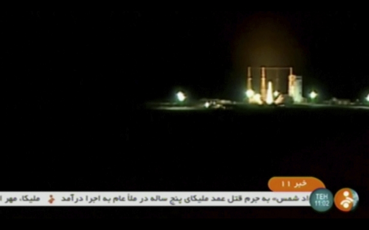 """In this frame grab from Iranian state TV, a video, a rocket carrying a Payam satellite is launched at Imam Khomeini Space Center, a facility under the control of the country's Defense Ministry, in Semnan province, Iran, Tuesday, Jan. 15, 2019. According to Telecommunications Minister Mohammad Javad Azari Jahromi, the rocket failed to reach the """"necessary speed"""" in the third stage of its launch. (IRINN, via AP)"""