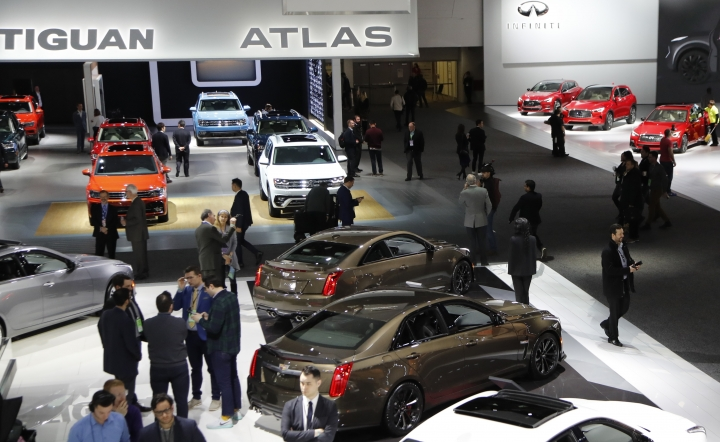 Overview of the Cadillac, Volkswagen and Infiniti display, Tuesday, Jan. 15, 2019, at the North American International Auto Show in Detroit. (AP Photo/Carlos Osorio)