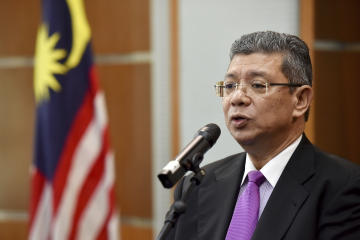 Malaysia Foreign Minister Saifuddin Abdullah speaks during a press conference in Putrajaya, Malaysia, Wednesday, Jan. 16, 2019. Malaysia's foreign minister says the government will not budge over a ban on Israeli athletes in para swimming competition and decided that the country will not host any events in future involving Israel. (AP Photo/Yam G-Jun)