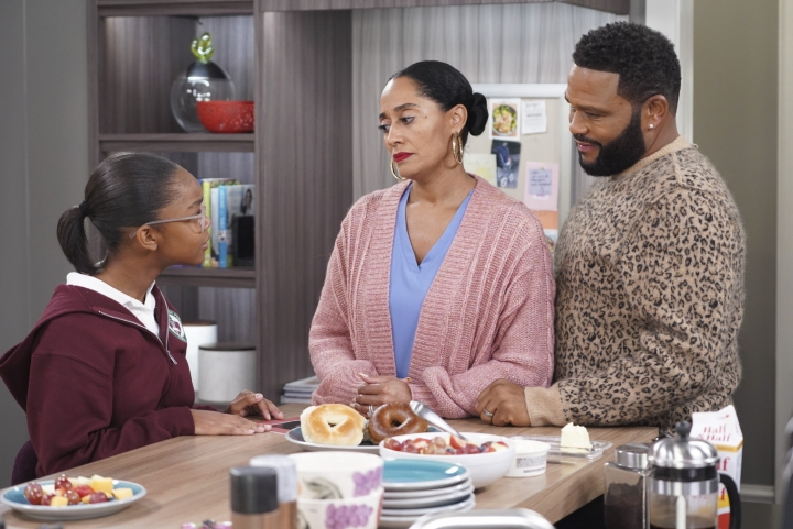 "This image released by ABC shows Marsai Martin, from left, Tracee Ellis Ross and Anthony Anderson in a scene from ""black-ish."" In the episode airing on Tuesday, Jan. 15, Dre, played by Anderson, and Bow, played by Ross, are furious after Diane, played by Martin, isn't lit properly in her class photo. The episode outlines the history of colorism in depth while injecting some humor. (Ron Tom/ABC via AP)"