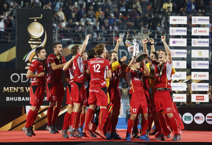 FILE - In this Sunday, Dec. 16, 2018 file photo, Belgium players celebrate with the winners trophy after their win over Netherlands in the Men's Hockey World Cup finals at Kalinga Stadium in Bhubaneswar, India. On Saturday Jan. 19, 2019, Thierry Weil will be in Valencia as the International Hockey Federation's CEO so see Spain host top-ranked world champion Belgium in the first men's game of the FIH Pro League. (AP Photo/Aijaz Rahi, File)