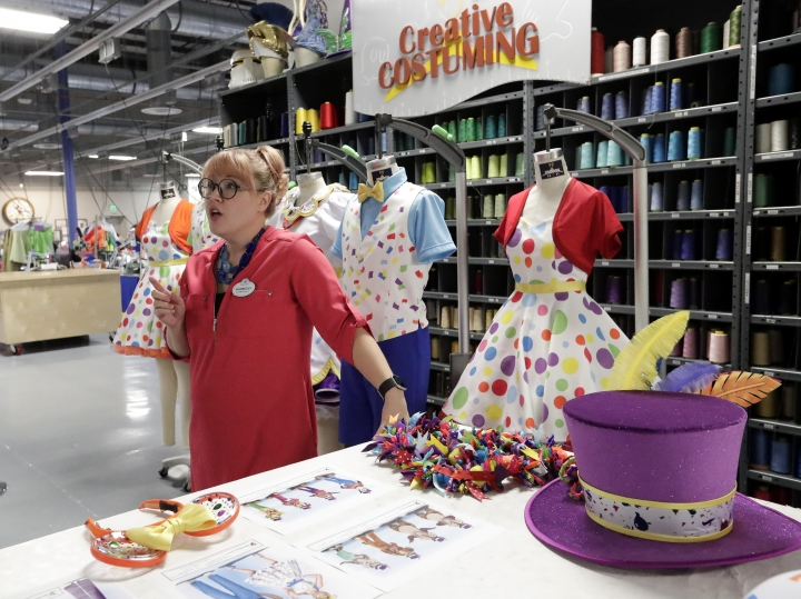 In this Wednesday, Jan. 9, 2019 photo, Harmony McChesney, costume designer discusses the work that goes in to creating costumes at Walt Disney World in Lake Buena Vista, Fla. Durability is a must since the costumes worn by dancers, singers and costumed characters are washed every day. (AP Photo/John Raoux)