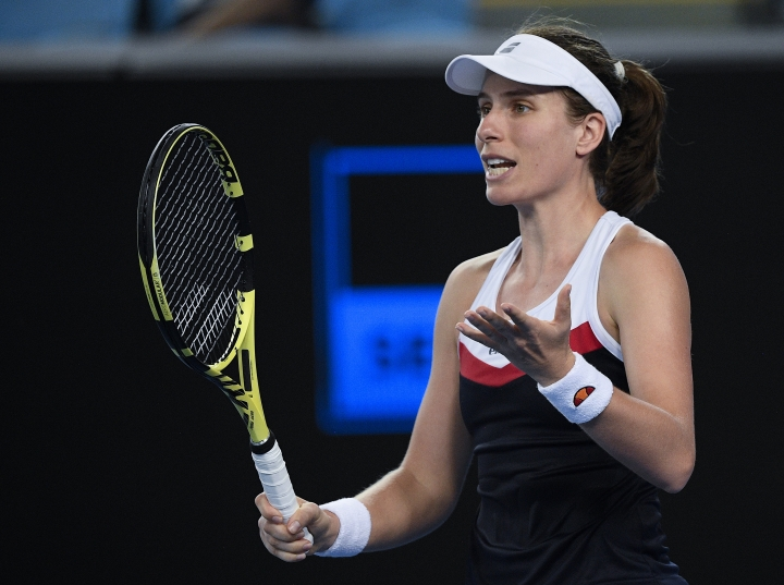 Britain's Johanna Konta reacts during her second round match against Spain's Garbine Muguruza at the Australian Open tennis championships in Melbourne, Australia, Friday, Jan. 18, 2019. (AP Photo/Andy Brownbill)