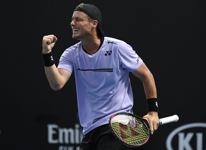 Australia's Lleyton Hewitt celebrates with compatriot John-Patrick Smith during their first round doubles match against New Zealand's Marcus Daniels and Wesly Koolhof of the Netherlands at the Australian Open tennis championships in Melbourne, Australia, Thursday, Jan. 17, 2019. (AP Photo/Andy Brownbill)