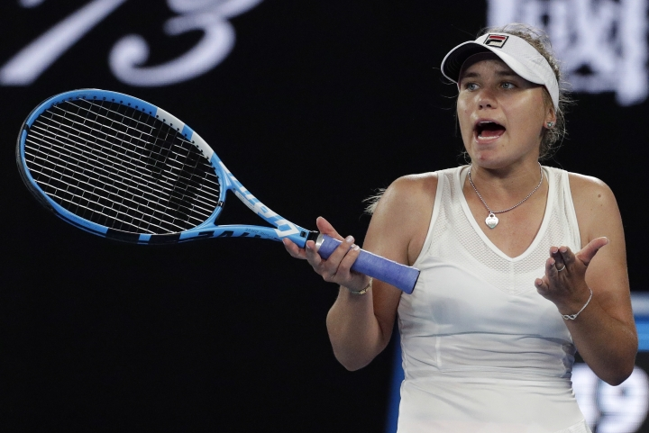 United States' Sofia Kenin reacts during her second round match agains Romania's Simona Halep at the Australian Open tennis championships in Melbourne, Australia, Thursday, Jan. 17, 2019. (AP Photo/Aaron Favila)