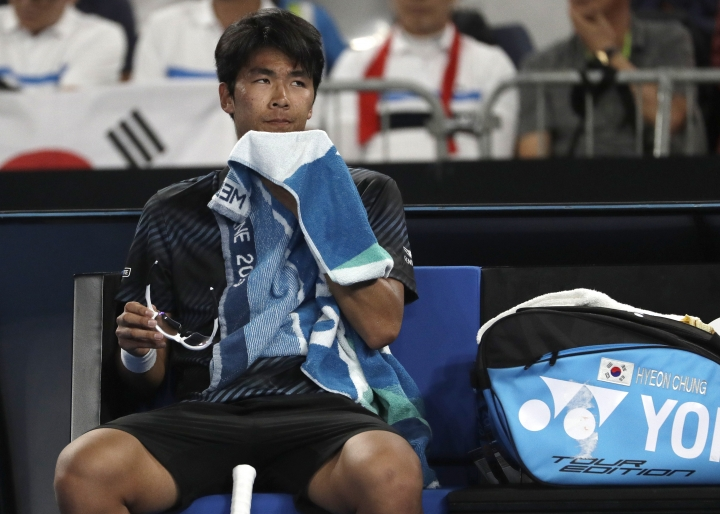South Korea's Chung Hyeon sits in his chair during a break in his second round loss to France's Pierre-Hugues Herbert at the Australian Open tennis championships in Melbourne, Australia, Thursday, Jan. 17, 2019. (AP Photo/Mark Schiefelbein)