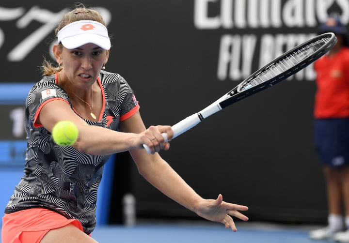 Belgium's Elise Mertens makes a backhand return to Russia's Margarita Gasparyan during their second round match at the Australian Open tennis championships in Melbourne, Australia, Thursday, Jan. 17, 2019. (AP Photo/Andy Brownbill)