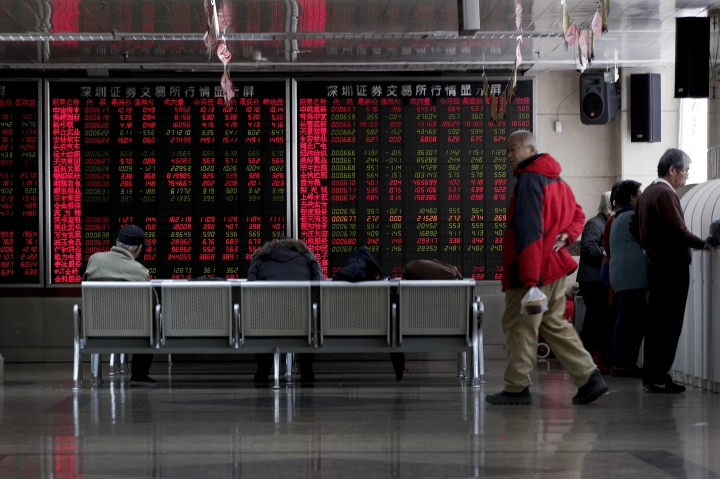 Investors monitor stock prices at a brokerage house in Beijing, Friday, Jan. 18, 2019. Chinese stocks rose Friday on signs of possible progress in negotiations over Beijing's tariff war with Washington. (AP Photo/Andy Wong)