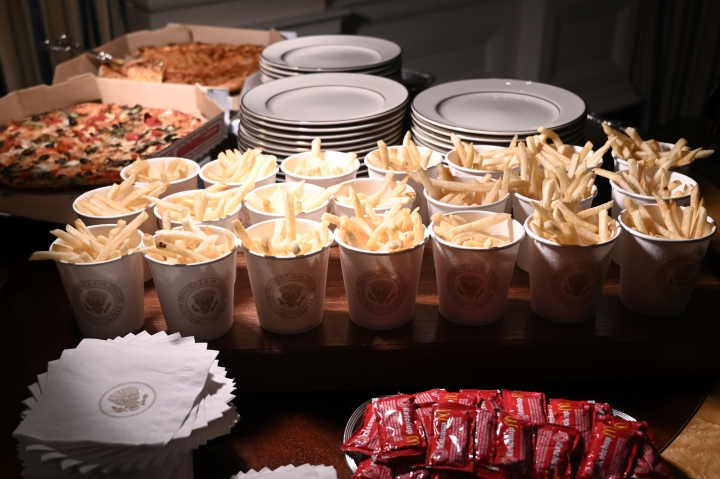 In this Jan. 14, 2019 photo, french fries and pizza are some of the fast food items for the reception for the Clemson Tigers in the State Dining Room of the White House in Washington. The partial government shutdown is hitting home for President Donald Trump in a very personal way. He lives in government-run housing, after all. Just 21 of the roughly 80 people who help care for the White House _ from butlers to electricians to chefs _ are reporting to work. The rest have been furloughed. (AP Photo/Susan Walsh)