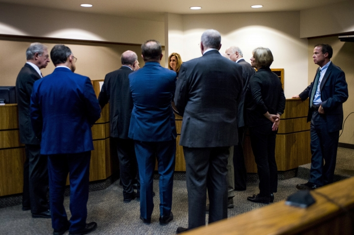 "FILE - In this Monday, Jan. 8, 2018 file photo, attorneys meet with Genesee District Judge Jennifer J. Manley as preliminary examination begins in the cases of four defendants, all former or current officials from the Michigan Department of Environmental Quality at Flint District Court in downtown Flint, Mich. Michigan's attorney general in 2016 promised to investigate the Flint water scandal ""without fear or favor"" and pledged that state regulators would be locked up for fudging data and misleading the public about lead in the poor city's pipes. Yet three years later, no one is behind bars. (Jake May/The Flint Journal-MLive.com via AP)"
