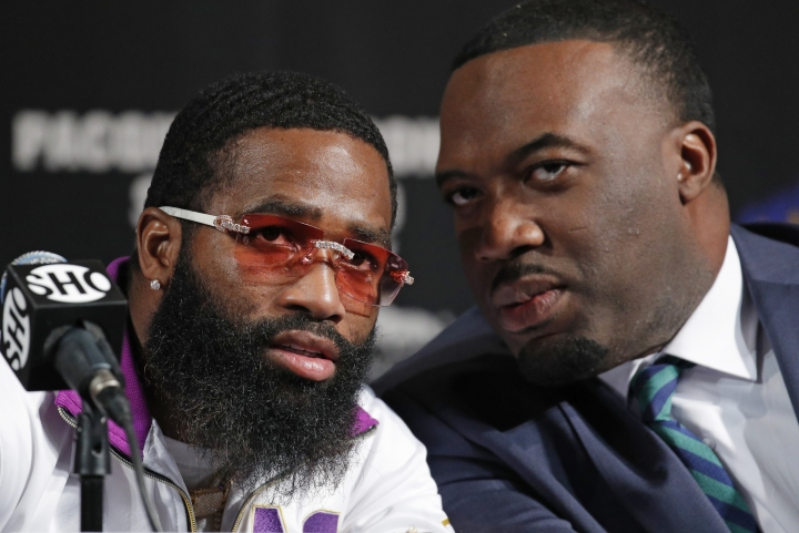 Adrien Broner, left, speaks with his advisor Ravone Littlejohn during a news conference Wednesday, Jan. 16, 2019, in Las Vegas. Broner is scheduled to fight Manny Pacquiao in a welterweight championship bout on Saturday. (AP Photo/John Locher)