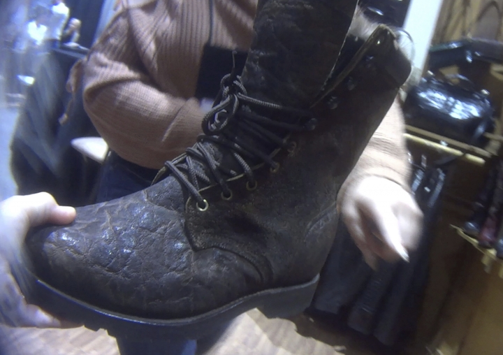 In this image provided by the Humane Society of the United States, a hunting boot, labeled that it was made from elephant hide, is displayed at the Safari Club International conference in Reno, Nev., on Jan. 9, 2019. Photos and video taken by animal welfare activists show an array of potentially illicit products crafted from the body parts of threatened big-game animals, including boots, chaps, belts and furniture labeled as elephant leather. (Humane Society of the United States via AP)
