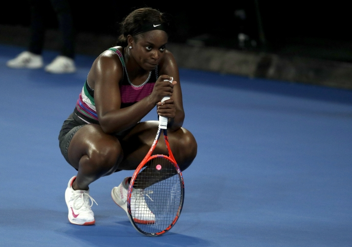 United States' Sloane Stephens rests on her racket during her fourth round match against Russia's Anastasia Pavlyuchenkova during at the Australian Open tennis championships in Melbourne, Australia, Monday, Jan. 21, 2019. (AP Photo/Mark Schiefelbein)