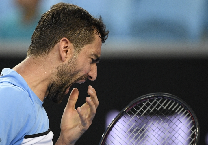 Croatia's Marin Cilic reacts after losing a point to Spain's Roberto Bautista Agut during their fourth round match at the Australian Open tennis championships in Melbourne, Australia, Sunday, Jan. 20, 2019. (AP Photo/Andy Brownbill)