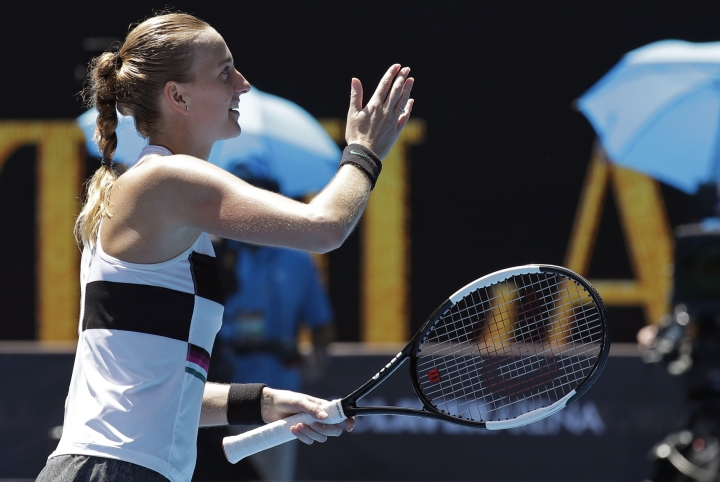 Petra Kvitova of the Czech Republic celebrates after defeating United States's Amanda Anisimova during their fourth round match at the Australian Open tennis championships in Melbourne, Australia, Sunday, Jan. 20, 2019. (AP Photo/Aaron Favila)