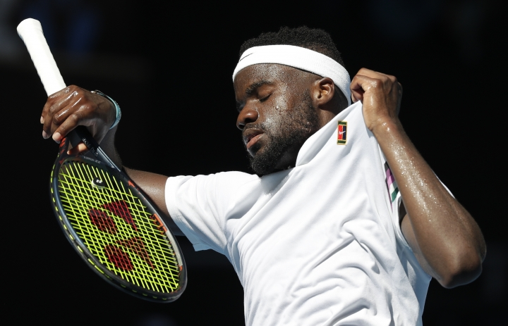 United States' Frances Tiafoe reacts after serving to Bulgaria's Grigor Dimitrov during their fourth round match at the Australian Open tennis championships in Melbourne, Australia, Sunday, Jan. 20, 2019. (AP Photo/Kin Cheung)