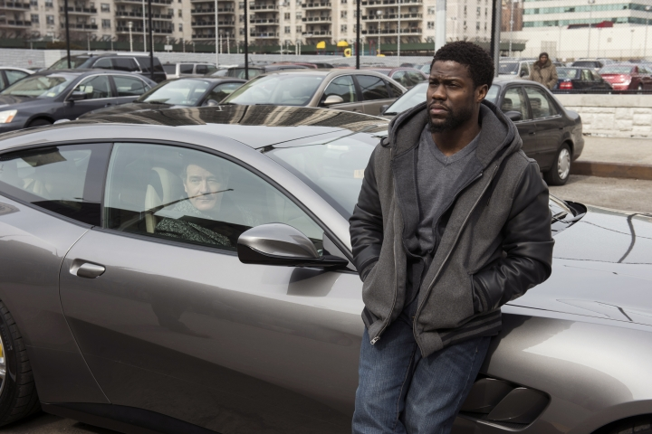 """This image released by STXfilms shows Bryan Cranston, left, and Kevin Hart in a scene from the film, """"The Upside."""" (David Lee/STXfilms via AP)"""