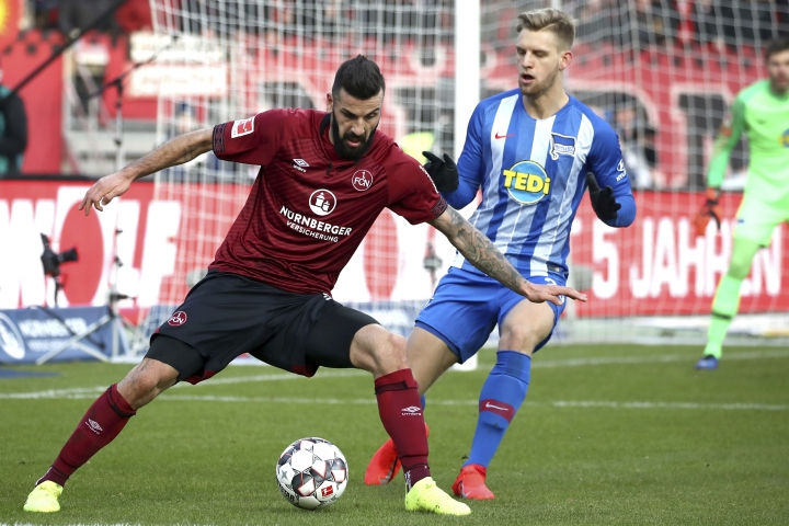 Nuremberg's Mikael Ishak, left, and Berlin's Arne Maier, right, challenge for the ball during the German Bundesliga soccer match between 1. FC Nuremberg and Hertha BSC Berlin in Nuremberg, Germany, Sunday, Jan. 20, 2019. (Daniel Karmann/dpa via AP)