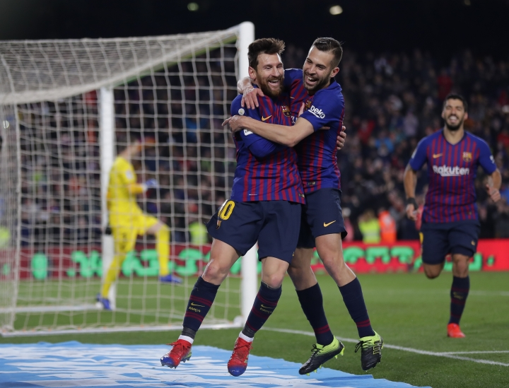 FC Barcelona's Lionel Messi, left, celebrates with his teammate Jordi Alba after scoring during the Spanish La Liga soccer match between FC Barcelona and Leganes at the Camp Nou stadium in Barcelona, Spain, Sunday, Jan. 20, 2019. (AP Photo/Manu Fernandez)