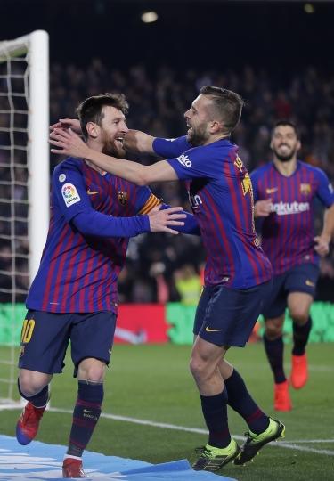 FC Barcelona's Lionel Messi, left, celebrates with his teammate Jordi Alba after scoring during the Spanish La Liga soccer match between FC Barcelona and Leganes at the Camp Nou stadium in Barcelona, Spain, Sunday, Jan. 20, 2019. (AP Photo/Manu Fernandez)