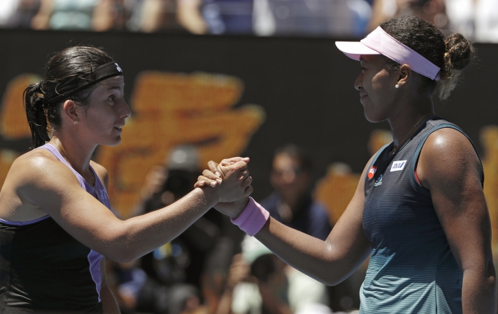 Japan's Naomi Osaka, right, is congratulated by Latvia's Anastasija Sevastova after winning their fourth round match at the Australian Open tennis championships in Melbourne, Australia, Monday, Jan. 21, 2019. (AP Photo/Mark Schiefelbein)