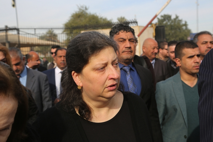 Noorah al-Gailani, center, attends her mother's funeral in Baghdad, Iraq, Monday, Jan. 21, 2019. Iraq is mourning the loss of Lamia al-Gailani, a beloved archaeologist who helped rebuild her country's leading museum in the aftermath of the U.S. invasion in 2003. (AP Photo/Khalid Mohammed)