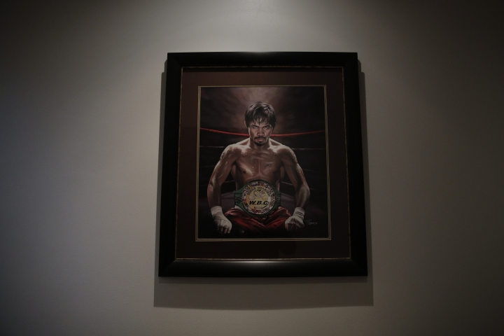 FILE - In this Jan. 14, 2019, file photo, a framed portrait of boxer Manny Pacquiao hangs in the foyer of his home in Los Angeles. A spokesman for Pacquiao says the famed fighter's Los Angeles home was robbed at about the time he was in the ring with rival Adrien Broner in Las Vegas. Spokesman Mike Quinn confirmed the burglary to NBC News. Los Angeles police said a burglary was reported about 4:15 p.m. Sunday, Jan. 20, 2019. in the Larchmont neighborhood. (AP Photo/Jae C. Hong, File)