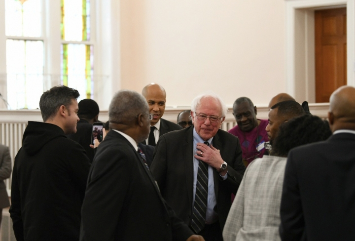 Sen. Cory Booker, D-N.J., and Sen. Bernie Sanders, I-Vt., greet people before a Martin Luther King Jr. prayer service at Zion Baptist Church in Columbia, S.C., on Monday, Jan. 21, 2019, during visits the state as they mull 2020 challenges to President Donald Trump. (AP Photo/Meg Kinnard)