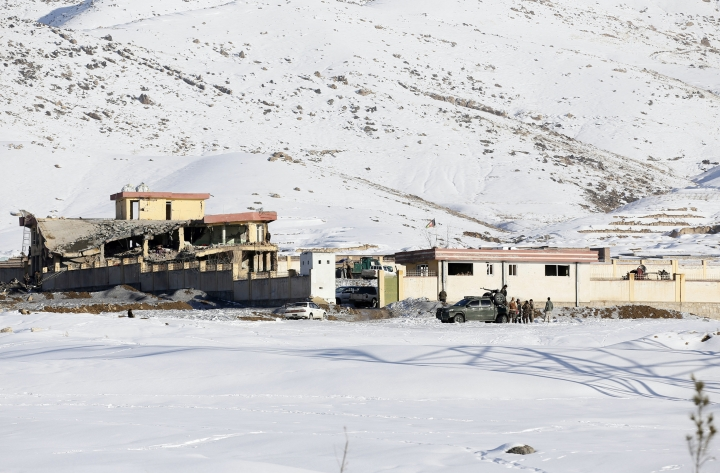 In this Monday, Jan. 21, 2019, photo, Afghan security forces inspect the site of a Taliban attack in Maidan Shar, capital of Maidan Wardak province, east of Kabul, Afghanistan. Afghan official said Tuesday, Jan. 22, 2019, scores of people mostly military personals were killed in the Taliban assault on a military base and a pro-government militia training center a day earlier in the province. (AP Photo)