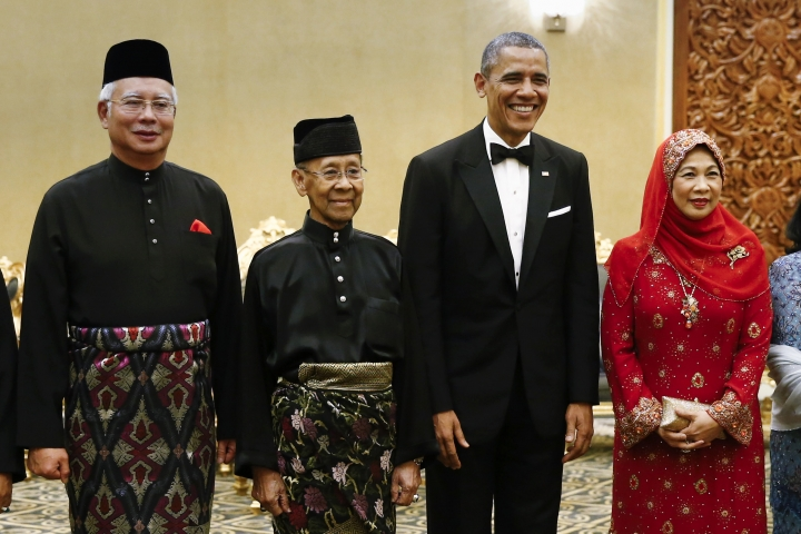 FILE - In this April 26, 2014, file photo, then U.S. President Barack Obama, second from right, stands with Malaysian King Sultan Abdul Halim Mu'adzam Shah, second from left, and Malaysian Queen Haminah Hamidun and Malaysian Prime Minister Najib Razak before a state dinner at National Palace in Kuala Lumpur, Malaysia. Sultan Muhammad V shocked the nation by announcing his abdication in January 2019, days after returning from two months of medical leave. The 49-year-old sultan from eastern Kelantan state only reigned for two years as Malaysia's 15th king and didn't give any reason for quitting. (AP Photo/Vincent Thian, File)