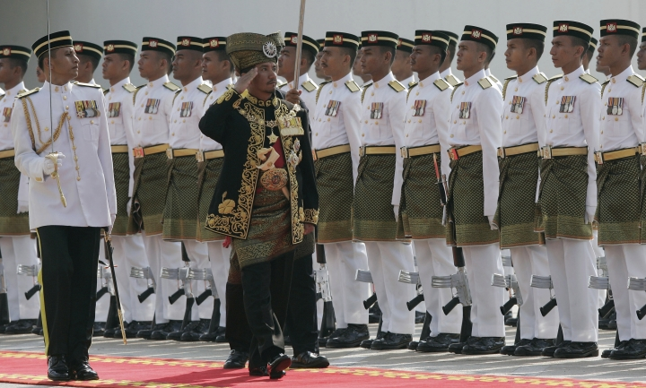 FILE - In this Feb. 16, 2009, file photo, then Malaysia's King Sultan Mizan Zainal Abidin, center, inspects the guard of honor during the opening of the parliament in Kuala Lumpur, Malaysia. King Sultan Muhammad V shocked the nation by announcing his abdication in January 2019, days after returning from two months of medical leave. The 49-year-old sultan from eastern Kelantan state only reigned for two years as Malaysia's 15th king and didn't give any reason for quitting. (AP Photo/Lai Seng Sin, File)