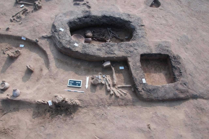 This undated handout photo provided by the Egyptian Antiquities Authority, shows a burial site dating back to the Predynastic Period in Kom al-Kholgan archaeological site, about 140 kilometers (87 miles) north of Cairo. The Antiquities Ministry said Wednesday, Jan. 23, 2019 that archaeologists have uncovered ancient tombs dating back to the Second Intermediate Period, 1782-1570 B.C., in the Nile Delta. (Egyptian Antiquities Authority via AP)